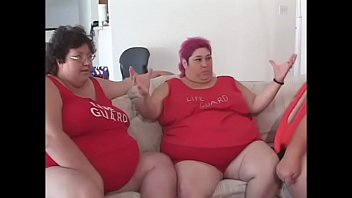 Fat bellied chick in red uniform Zazie Jeanette rides one long stick
