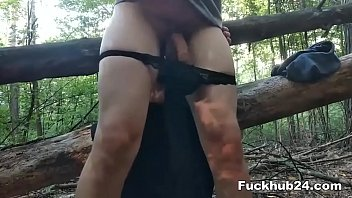 Pregnant mistress straponite and dominates her lover in the forest on the log