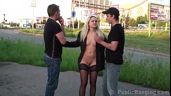 Blonde cutie fucked by 2 guys in public in the middle of a street