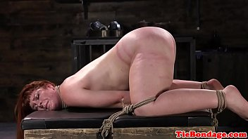 Spreadeagled bondage sub tied up and whipped