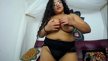 Brunette with big tits taking off her clothes for her boyfriend
