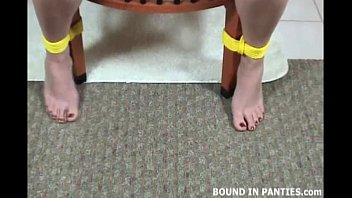 Angel corte bound tight with yellow ropes