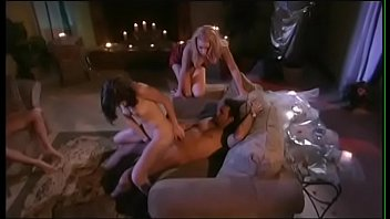 Two adorable chicks Olivia Saint and April Flowers are undressing one man for threesome sex on sofa