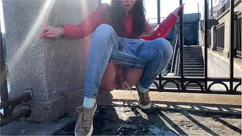Girl pee in a public place