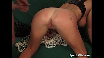 Busty MILF gets her ass spanked