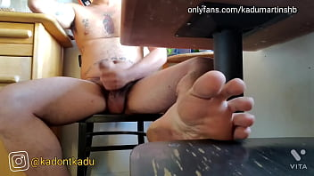 Nudist Hippie jerking off under the table