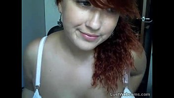 Busty redhead shows off her feet on webcam