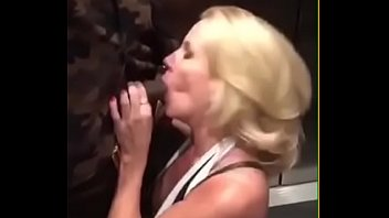 Blonde milf sucking black guy in Elevator in public with others watching