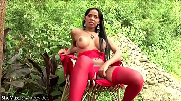 Stocking shemale tube T-girl in red lingerie exposes round breasts and massive ass