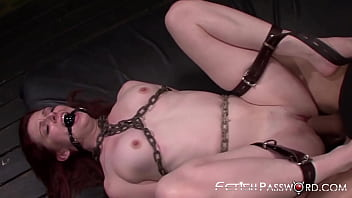 BDSM redhead Emma Evins stuffed with big dick in dungeon