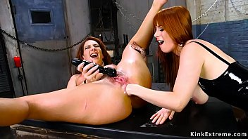 Redhead lesbian is rimmed and fucked
