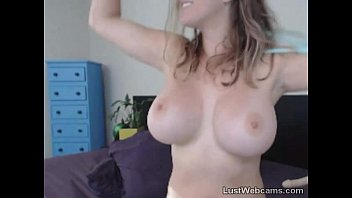 Big titted MILF masturbates with dildo on cam
