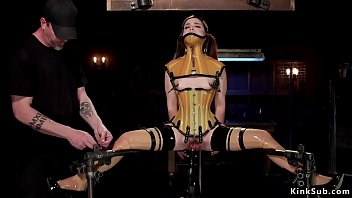 Brunette in rubber lingerie in device bondage