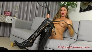 Mistress Chloe in sheer halter neck body about to whip her pathetic slave severely