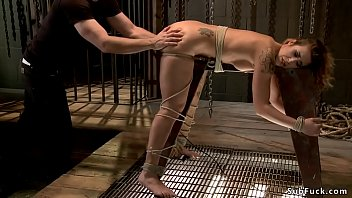 Gagged babe is fucked in suspension
