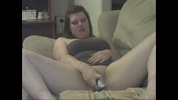 Wife playing on couch with toy