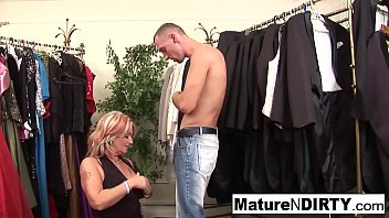 Granny fucks a y. man in the fitting room