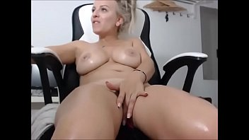 Horny blonde MILF is fingering her hairless pussy