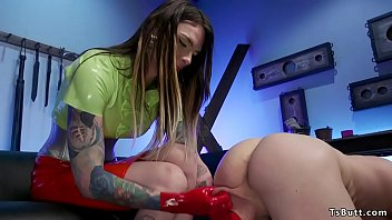 Shemale dom in latex gloves fists man