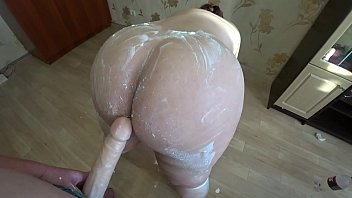 A lesbian plays with a cream, and then fucks with a girlfriend and shakes a fat cream booty. POV.