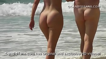 Wild nudist party - Sexy milf mom with a big ass walking naked on public beach