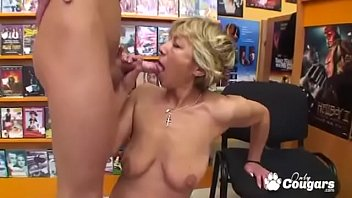 Mature Cougar Bangs Young Man In Video Store