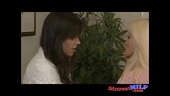 Two hot lesbians fuck with a strapon