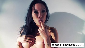 Asa Akira uses a fake hand to please her pussy