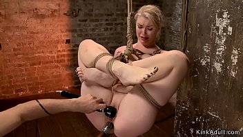 Blonde babe is anal toyed in suspension