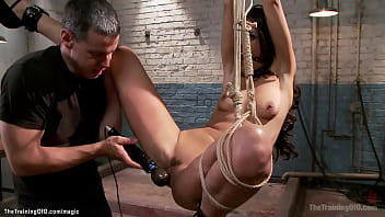 Slave in back bend bondage whipped