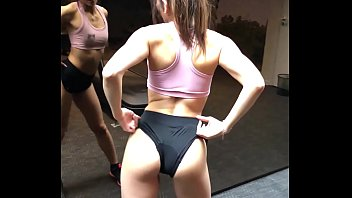 Brunette showing her ass at the gym