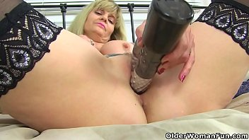 British and tattooed milf Kat puts her sex toy to work