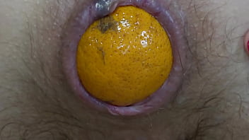 Beautiful booty pushes tangerines out of her hard anal Brunette in nylons masturbates asshole and hairy pussy and then sniffs and licks her thong Homemade fetish