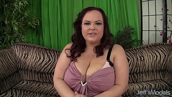 Hot big boobed plumper uses a red vibrator