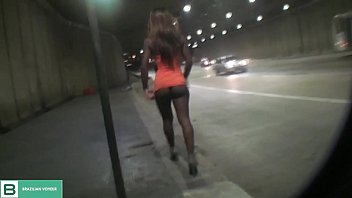 Brunette liftin g the dress in public in the m public in the middle of the city