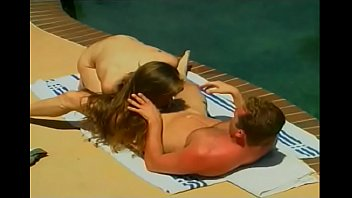 Lusty brunette has hardcore threesome with a young and an old guy by the pool
