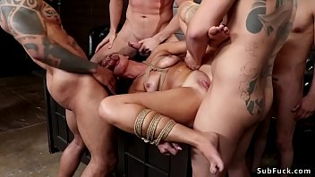 Tied slave is anal gangbang fucked