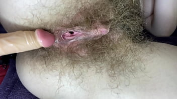 Hairy girl fucks her wet big clit pussy with dildo in close up