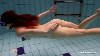 Big tits brunette Mia underwater naked