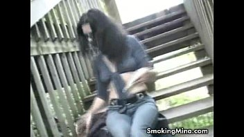 Horny Brunette Fingering Her Pussy While Smoking In The Stairway