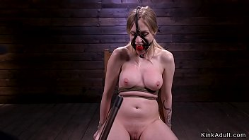 Blonde hogtied and laid on her stomach