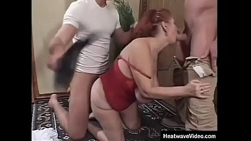 Horny granny fucked by two young tradesmen