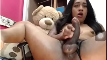 A sexy big dicked tranny jerking on web cam