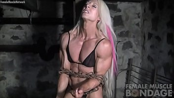 Free nude female bodybuilders - Female bodybuilders muscles strain against chains