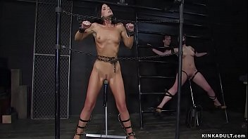 Two slaves in steel bondage vibrated