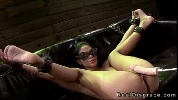 Chained on a couch babe gets fucked by fucking machine image
