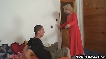 Old mother riding her man's cock