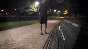 A young guy strips totally in a public park - (almost ?) caught by cyclist