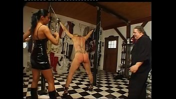 A helpless blonde tied up and flogged by a sadic couple