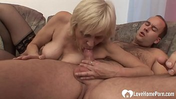 Luscious blonde granny takes his raging boner